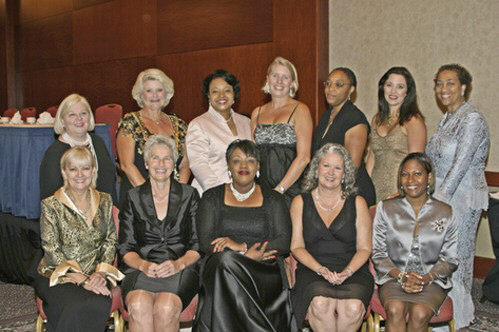 Sarahlyn Argrow, Founder/Executive Director of AWWIN (seated center) poses with award recipients.