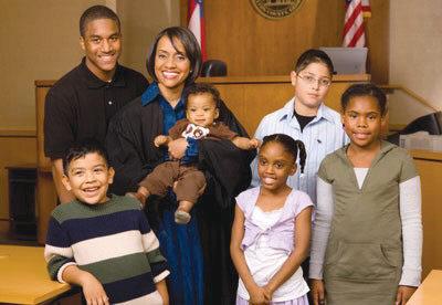 Judge Glenda Hatchett poses with foster care children.