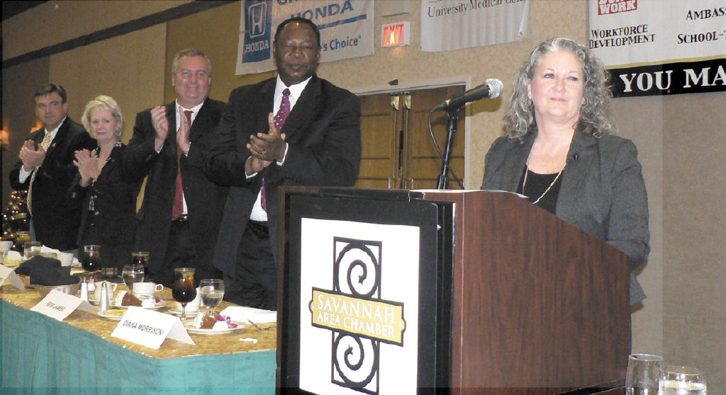 Shown above is Diana Morrison, 2009 Chairman of the Savannah Area Chamber. Board members Robert James, Bill Hubbard, Connie Farmer Ray, and Dana Mark look on.