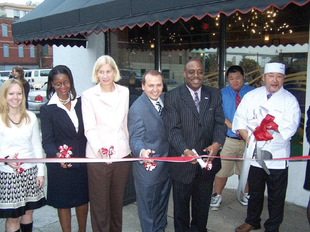 City officials join in ribbon cutting ceremony for Sushi-Zen.