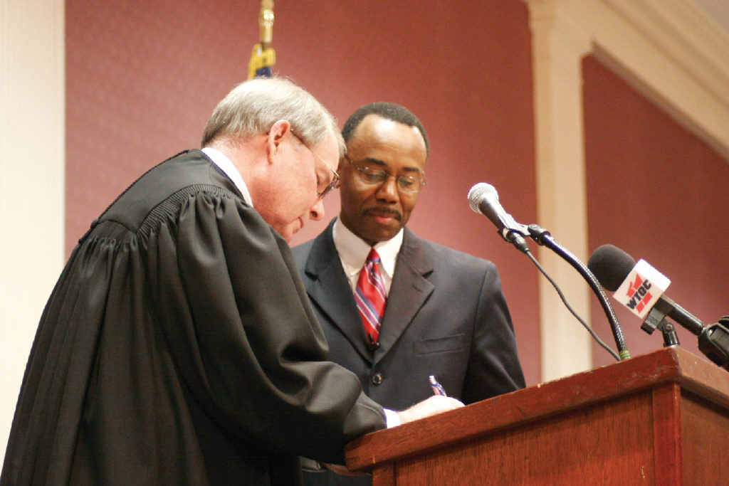 District Attorney Larry Chisolm was sworn by Judge Harris Lewis.