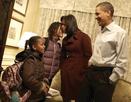 President-elect Barack and Michelle Obama pictured with Malia and Sasha before they headed off to school. Photo release by Obama Transition Team