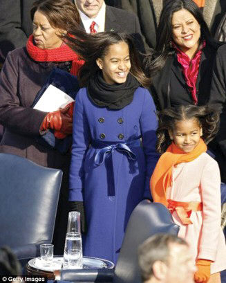 President Obama's daughters, Malia and Sasha, pictured with their grandmother Marian Robinson and aunt Maya Soetoro-Ng.