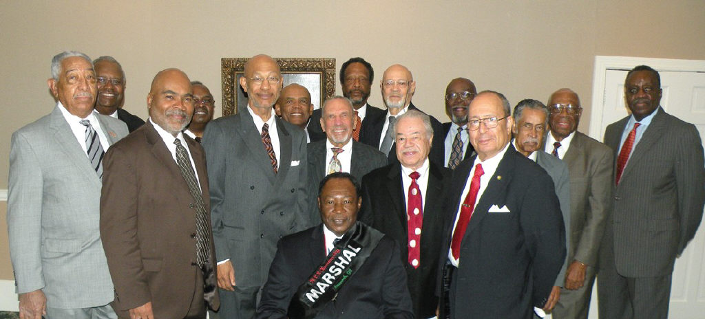 Robert E. James (seated) surrounded by other members of Alpha Lambda Boule.