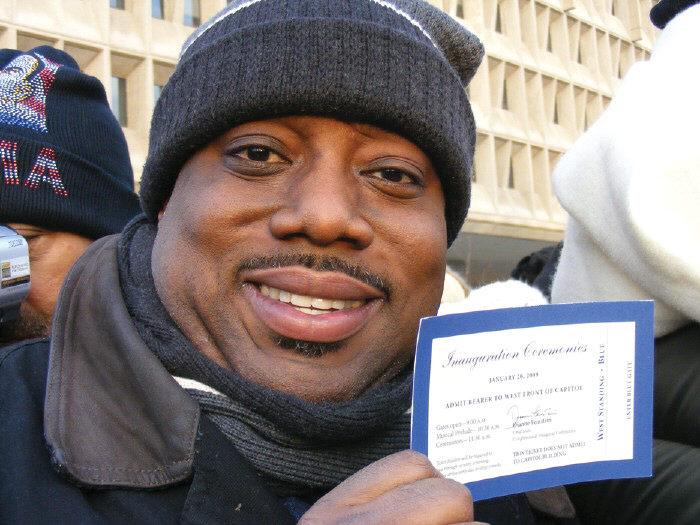 Alderman Van R. Johnson, II displays his Inaugural ticket.