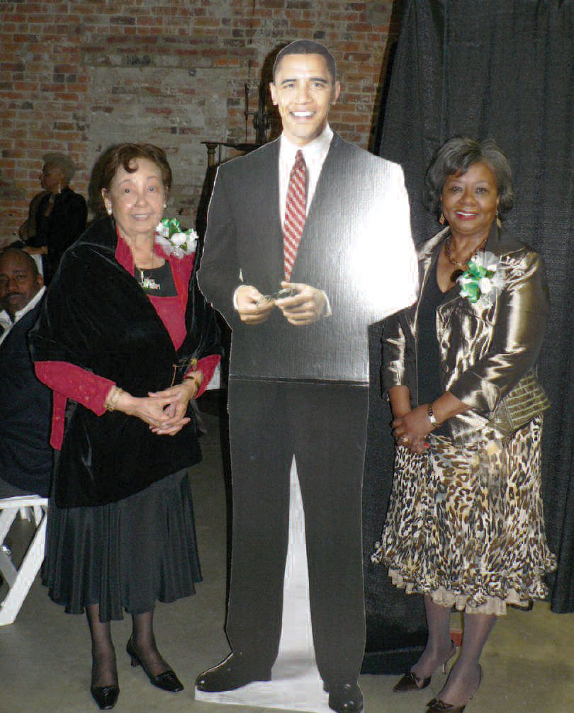 Platinum Member Link Wilhelmenia Dean and Link Virginia Edwards, Chapter President posing with life-size poster of President Obama.