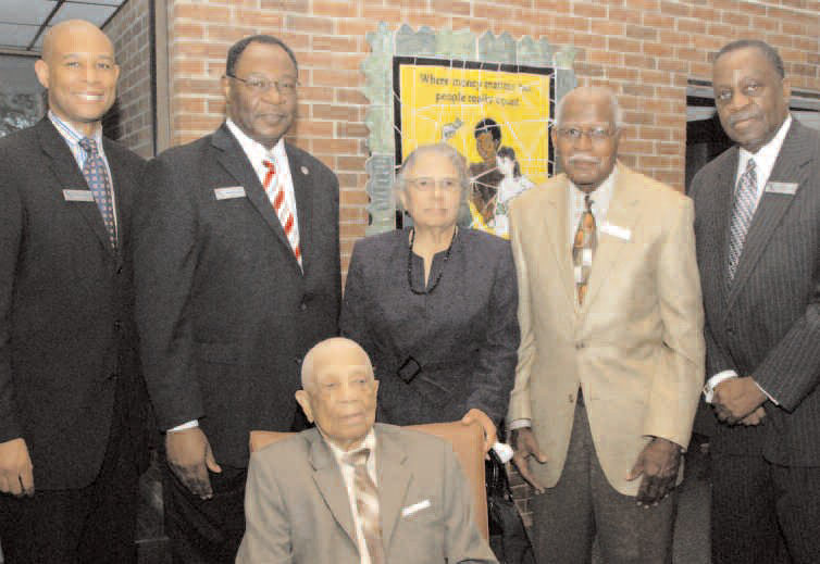 John B. Clemmons, Sr.(seated) is pictured with the other Carver Directors. L-R Robert E. James, II, Robert E. James, Mrs. Janie R. Toomer, Clifford E. Hardwick, III Hardwick, III, and Edward G. Miller.