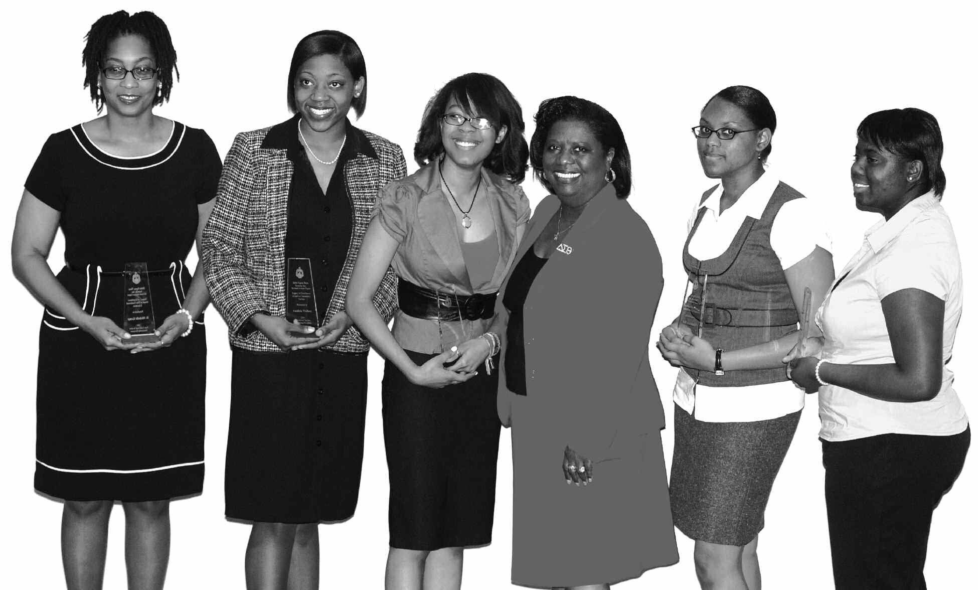 Carolyn Tremble, President, Savannah Alumnae is surrounded by the scholarship recipients.