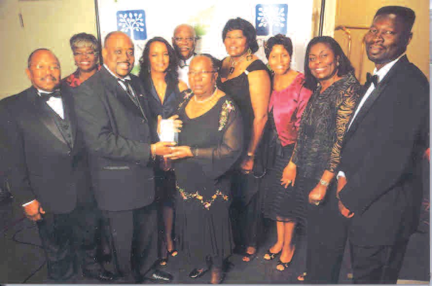 Van Johnson, President, Savannah Chapter NFBPA, is pictured with members after receiving award.