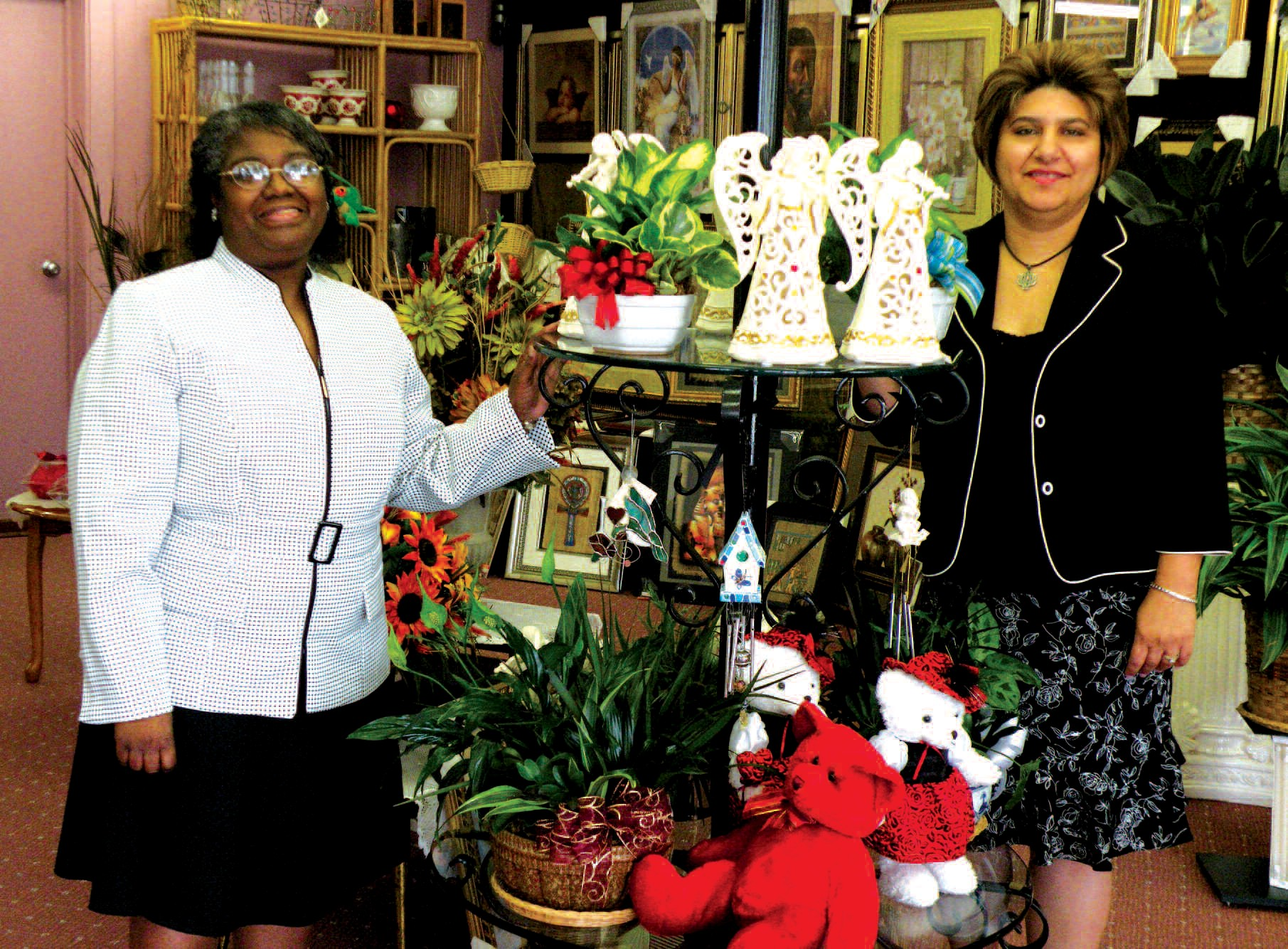 "Amira ""Amy"" Brown, (r) Owner/President, and Alice Ruth pose near a display in Peace of Mind located at 5548 Ogeechee Rd."