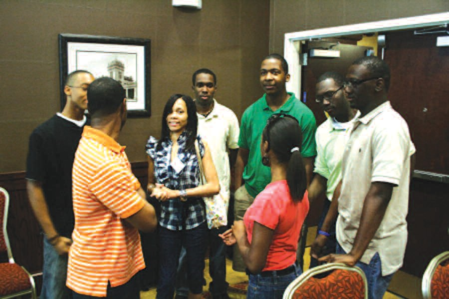 Members of the NAACP Youth and College Division converse.