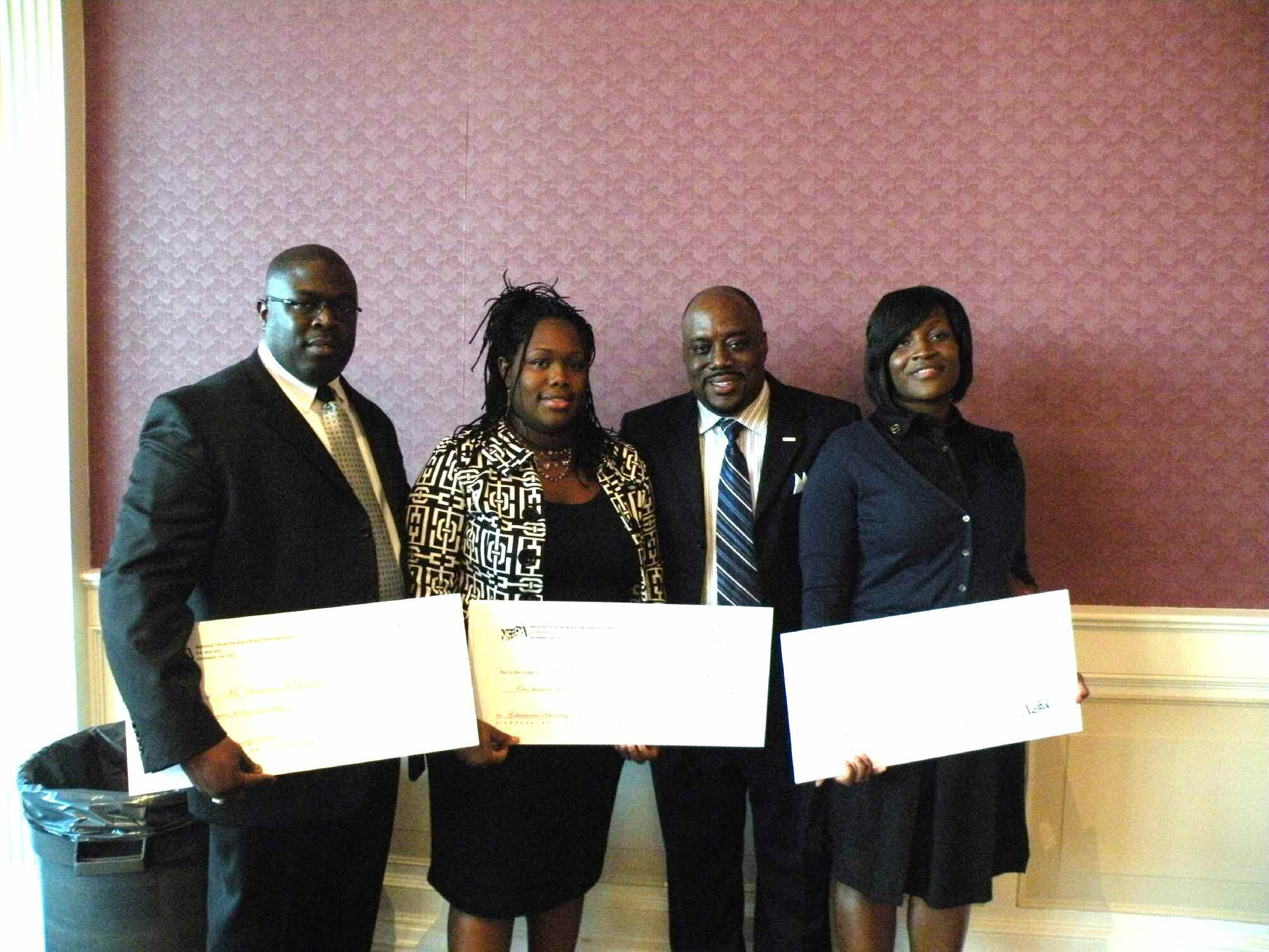 Pictured are scholarship recipients Shannon Holman, Ciarra M. Callis, Alderman Van Johnson II, President of the Savannah Metropolitan Chapter, NFBPA, and Whitney Parker.