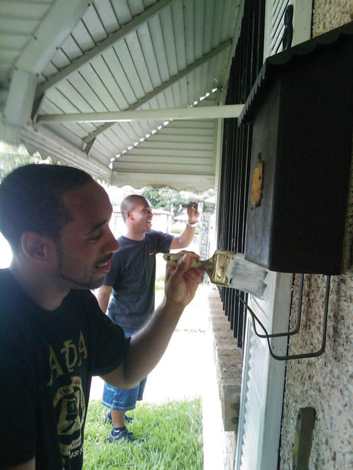 Members of Delta Eta Chapter of Alpha Phi Alpha Fraternity, Inc. participate in a community service project.