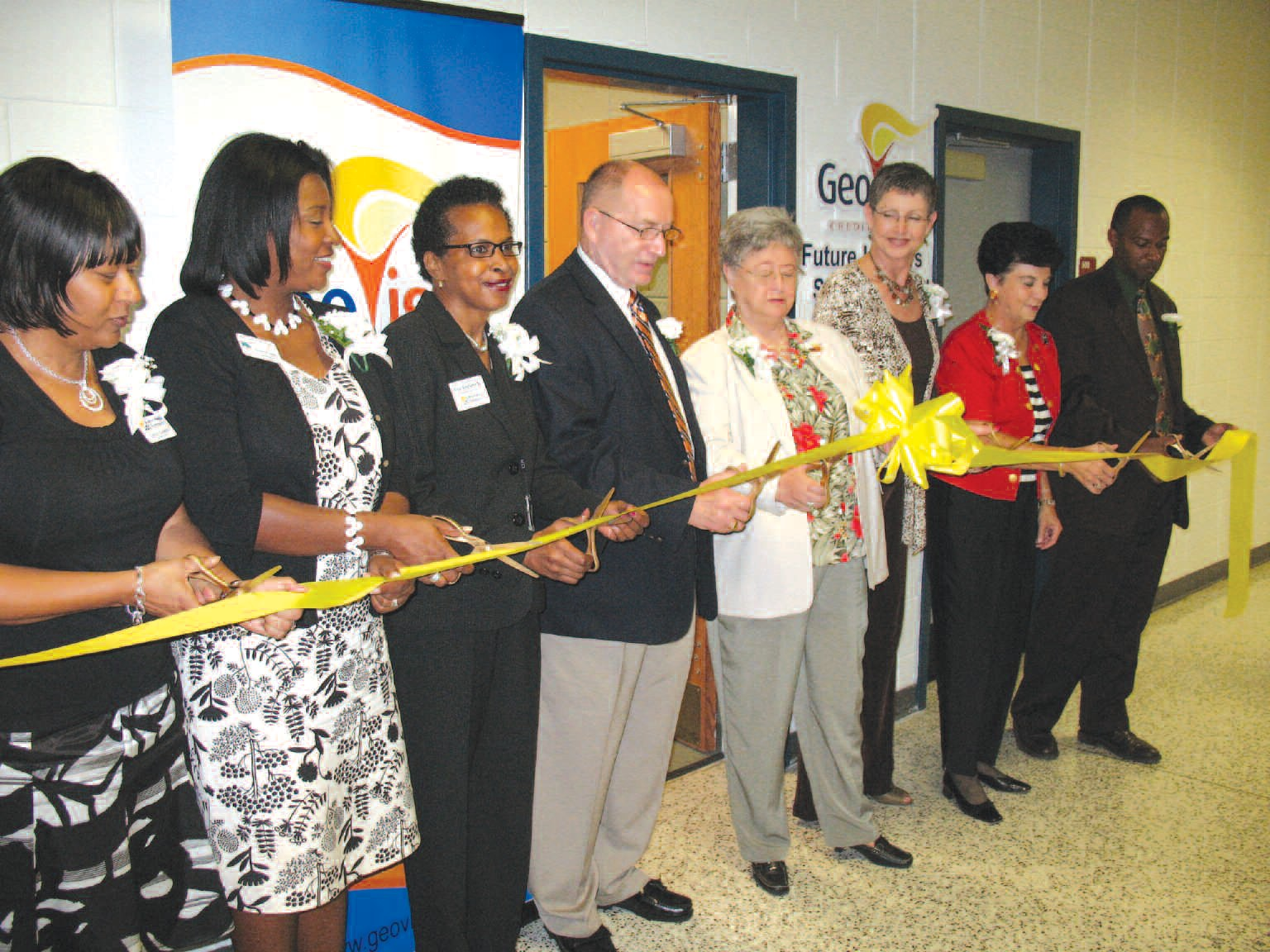 Among those participating in the ribbon cutting are Carol Gamble, center leader, is on the far left. Dr. Thomas Lockamy is in the center. To the right of Lockamy is Elaine Tuten, GeoVista CEO. And on the far right is Derrick Muhammad, center director and administrator.