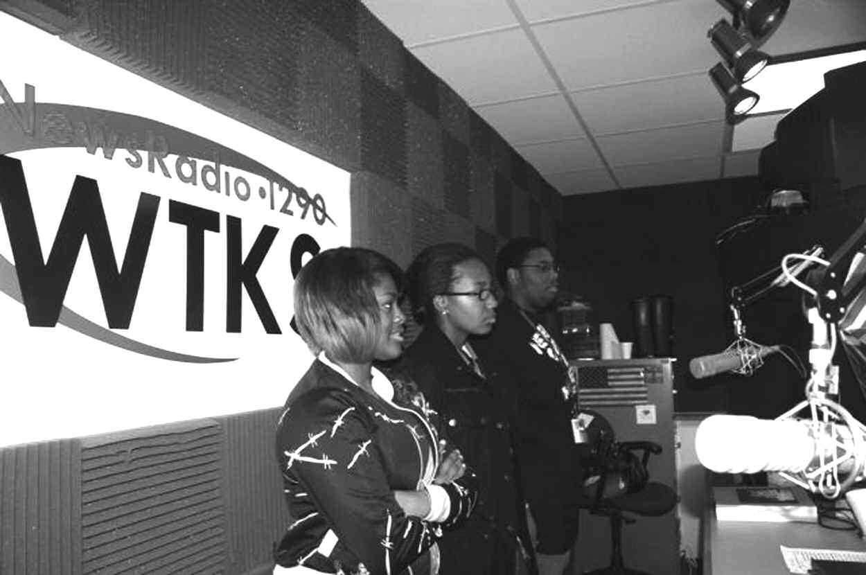 H.V. Jenkins High School students on the air at WTSK-AM, from left to right: Darnisha Green, Chelsea Williams and Jeremy Joshua