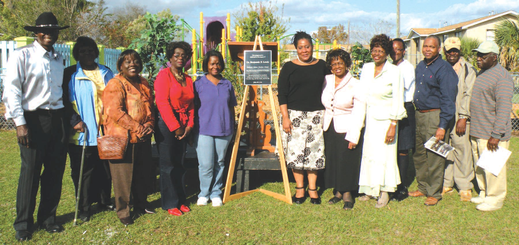 Family members of Ben Lewis pose for a photo during Friday's dedication