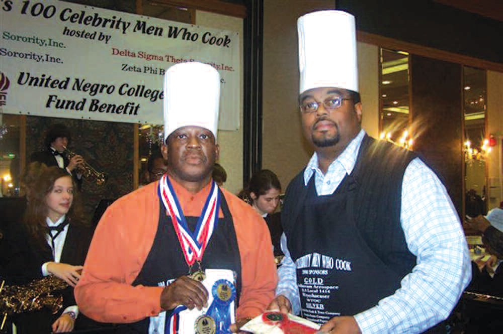 Winners Ronald Frazier and Reginald Stepherson show off their medals and ribbons