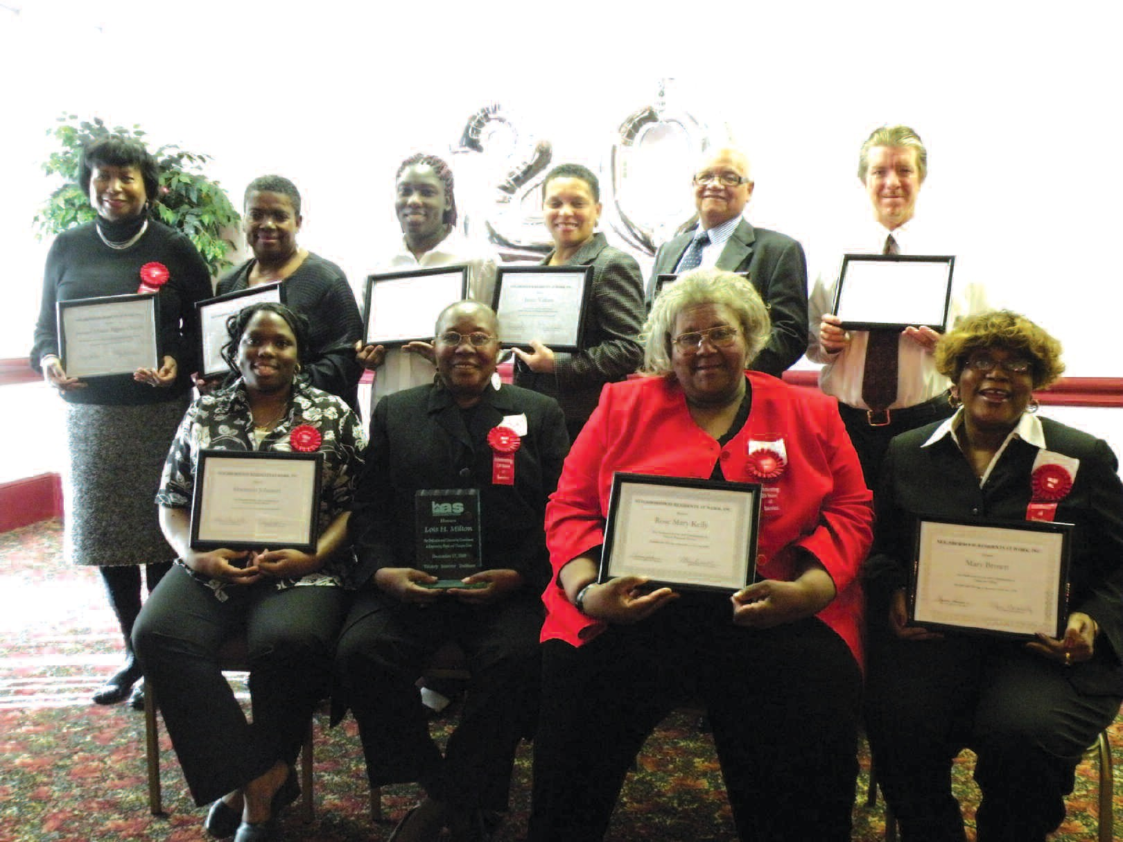Those in attendance were recognized for their dedication to public housing communities. Lois Milton, (second from left) was honored for her service as an employee of the Housing Authority of Savannah.