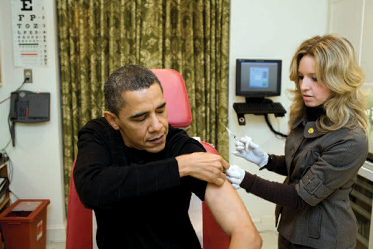 A White House nurse administers the swine flu vaccine to President Obama