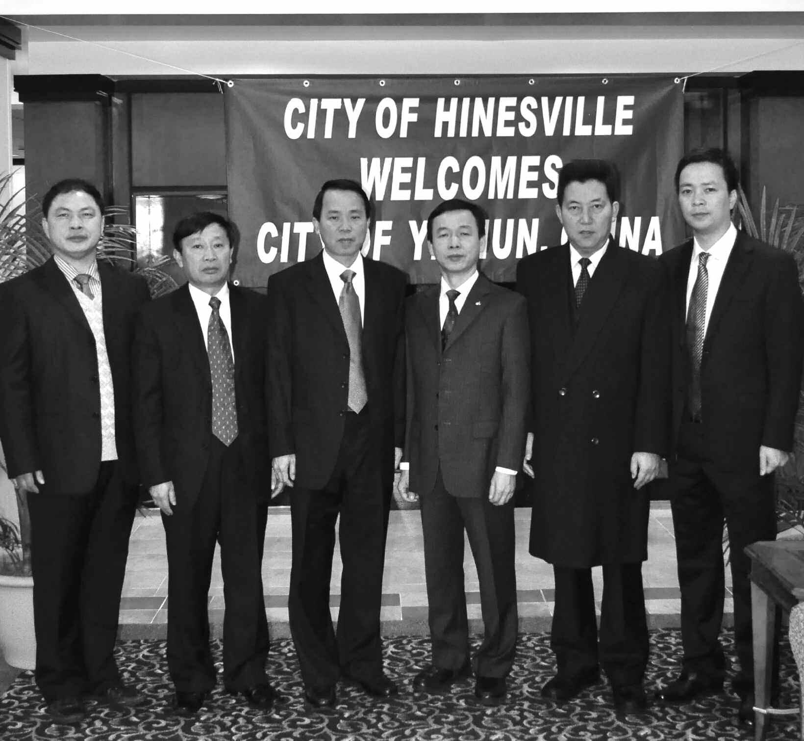 Delegates from left to right are Hu Quan Shun, Deputy Secretary of Economic Development; Zhang Baifu, Director of Foreign Affairs; Vice Mayor Yan Gan Hui, City of Yichun; Yang Guo Rong, Finance Bureau Chief of Yichun; Ye Jianhua, President of the Bank of China branch in Yichun; and Lin Haibing, General Manager of Jiangxi Sheng Fulai Directional Reflector Ltd. Co.