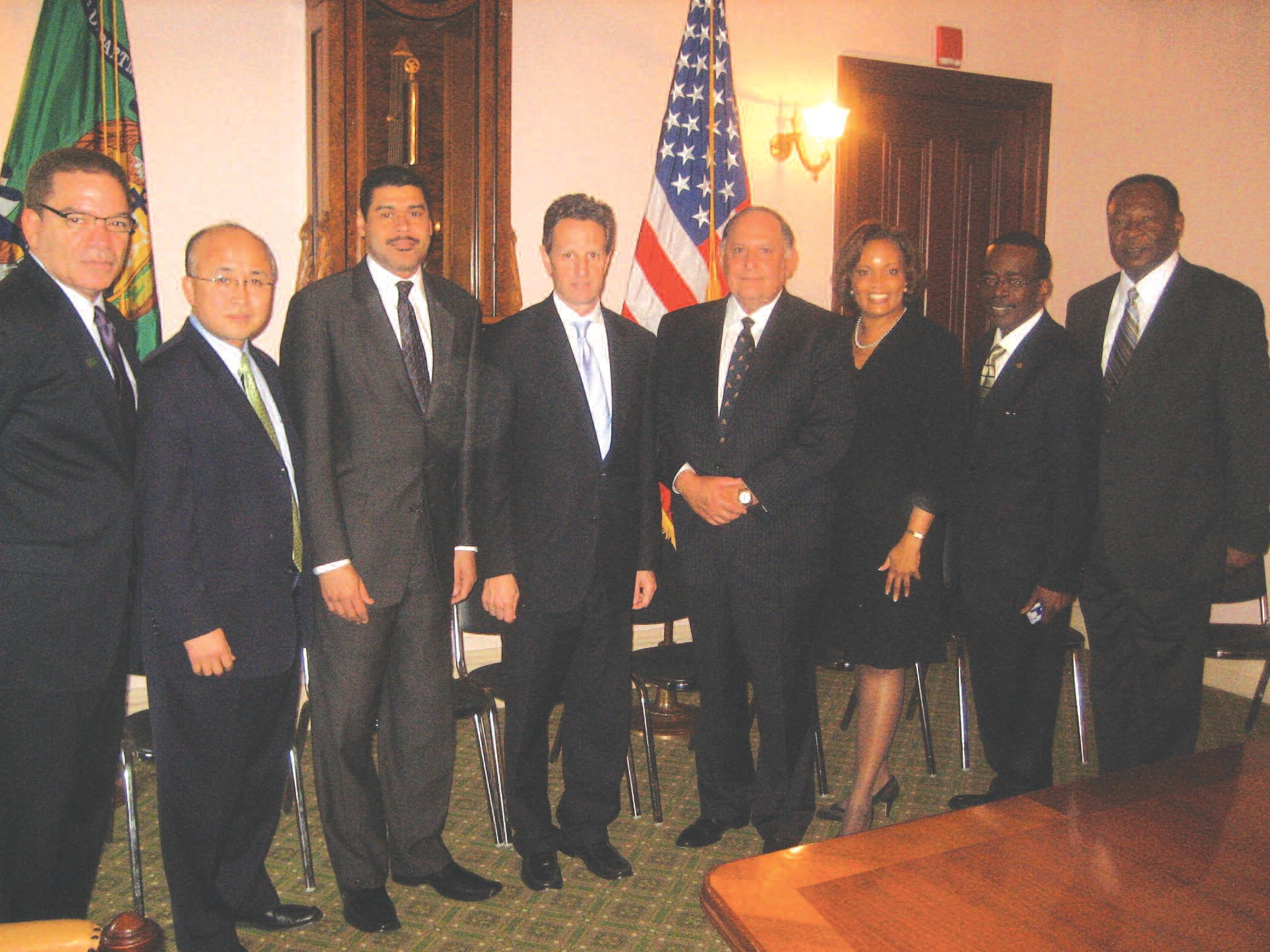 (Left to Right) Michael Grant, Paul Hyon, B. Doyle Mitchell, Jr, Treasury Secretary Timothy Geithner, Ignacio Urrabazo, Jr. , Kim D. Saunders, James Young, and Robert E. James.