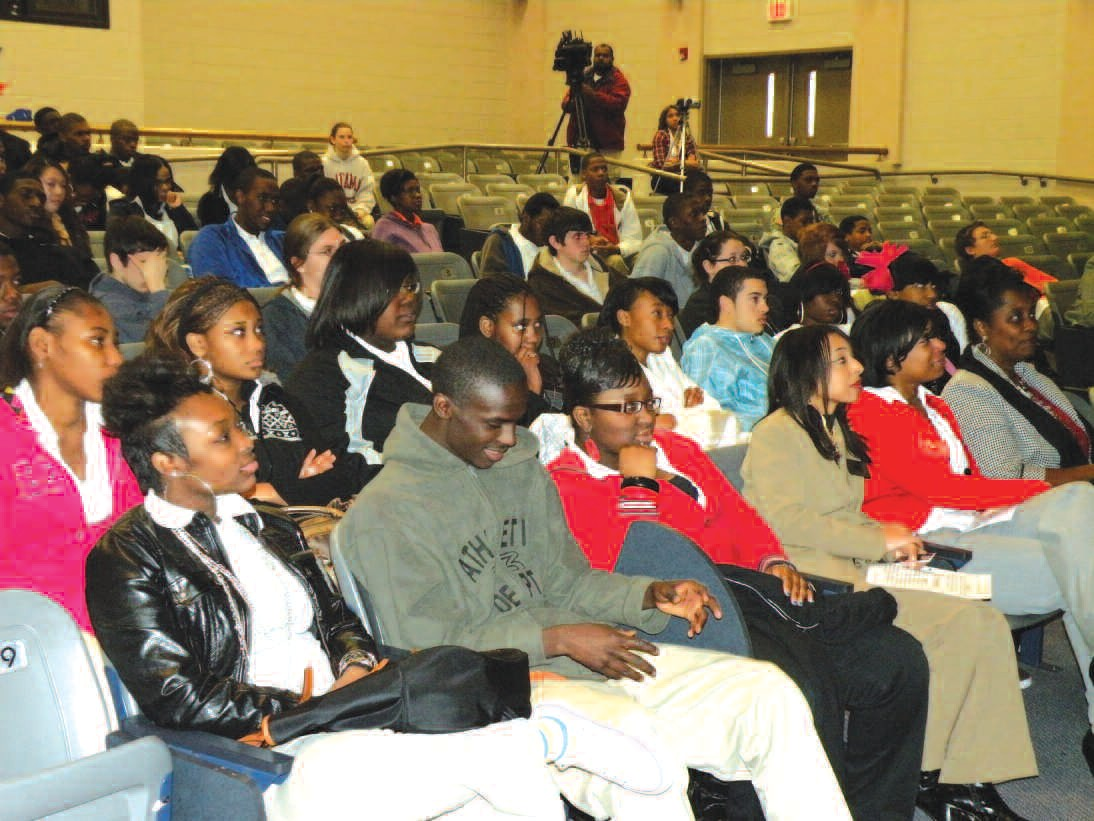 Students listen attentively during announcement of Economic Empowerment Program