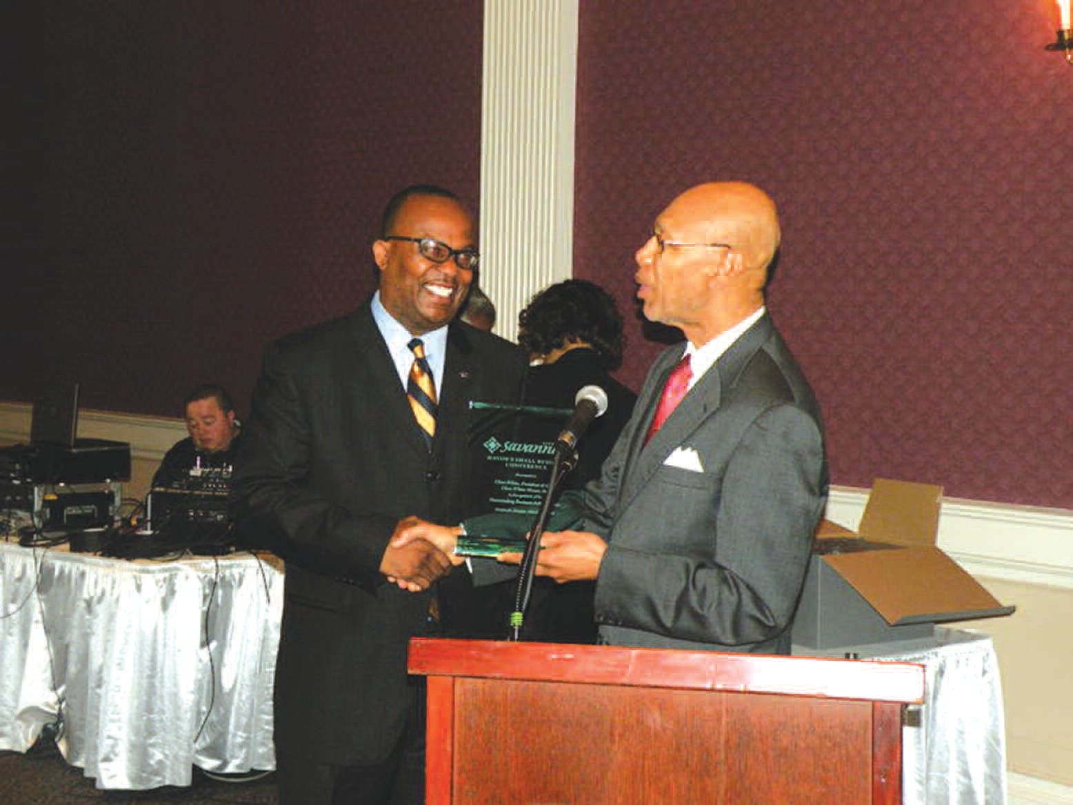 Cleve White, Cleve White Nissan is present an award from Mayor Otis Johnson