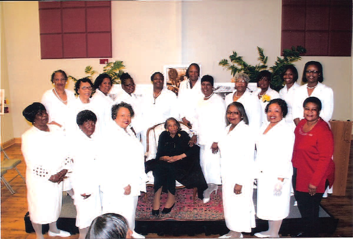 Sisters of the First District surround Savannah native Amelia Boynton Robinson during her recent return home