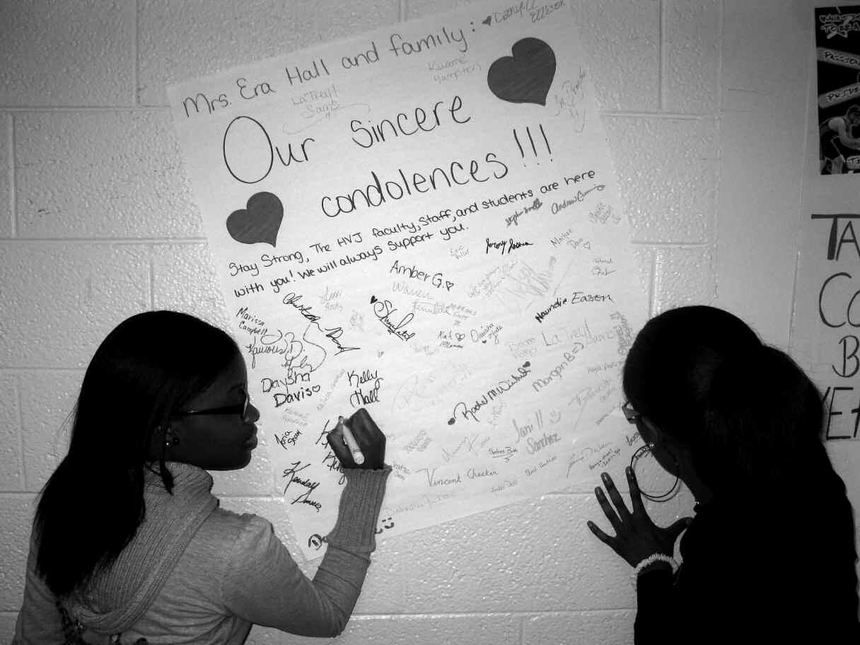 Rachel Winbush and Domanek Blake sign the poster for Mrs. Era Hall and Family