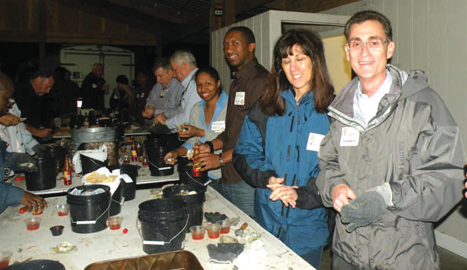 Chamber Chairman Bert Tennebaum shown with others in attendance at the Chamber's Annual Oyster Roast.