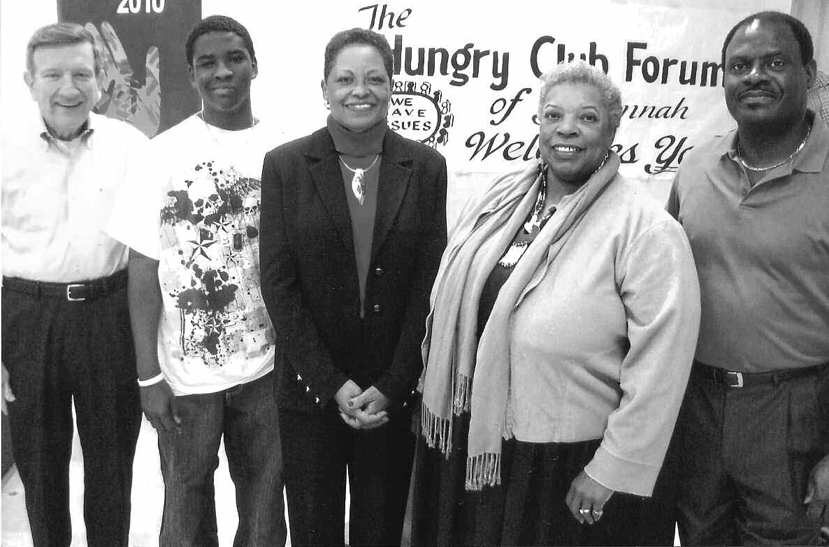 Shevon Carr (center) is greeted by (l-r) Chatham County Commission Chairman Pete Liakakis, Bethesda School student Tremil Copeland, Pinnacle Communications Consultant Diana Harvey Johnson and HCFS Interim President Mike Jones