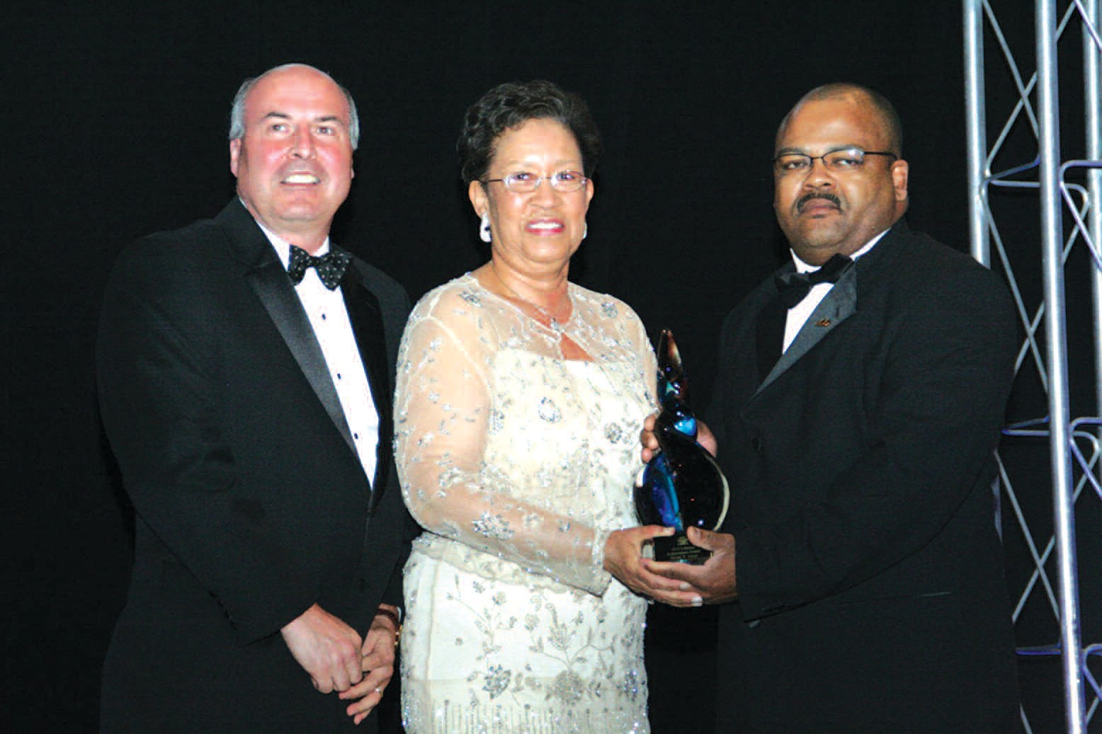 Shirley Barber James, (c) is pictured with Steve Brower and Ken Boler. Photo courtesy of D &D Photography