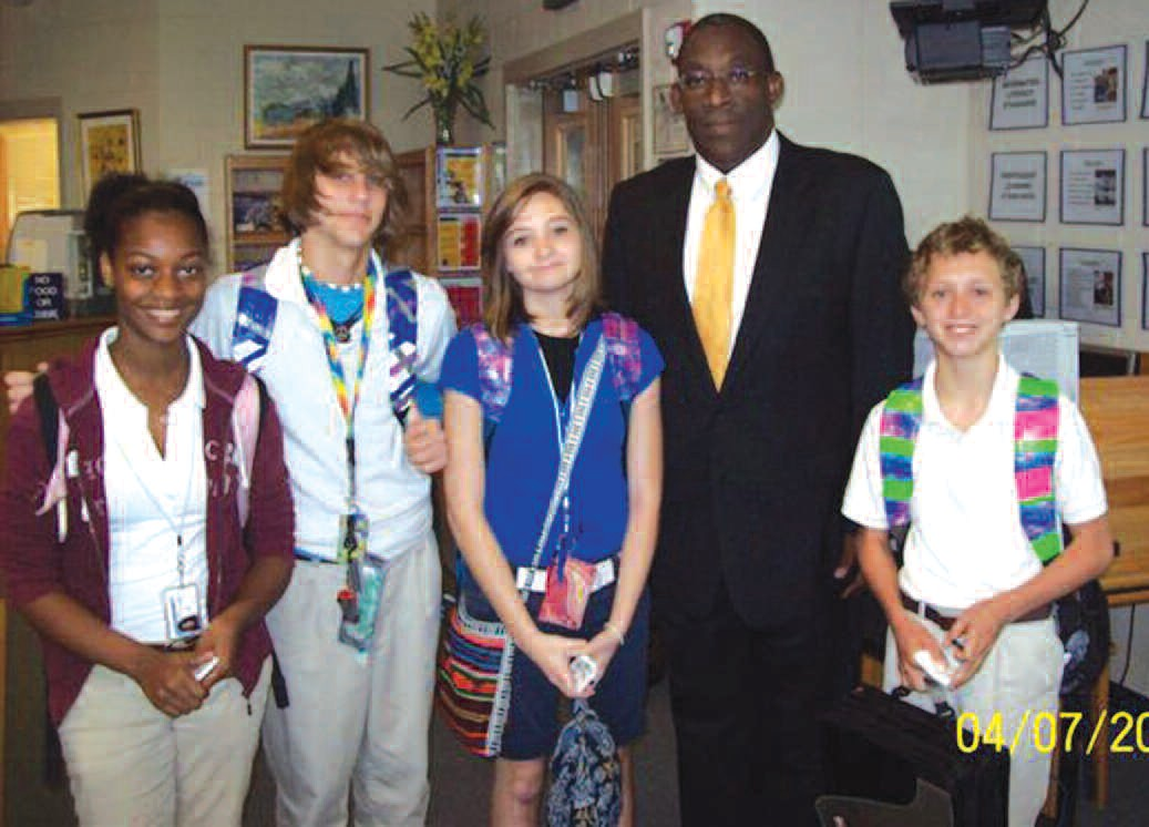 US Attorney Ed Tarver poses with DeRenne Middle School students