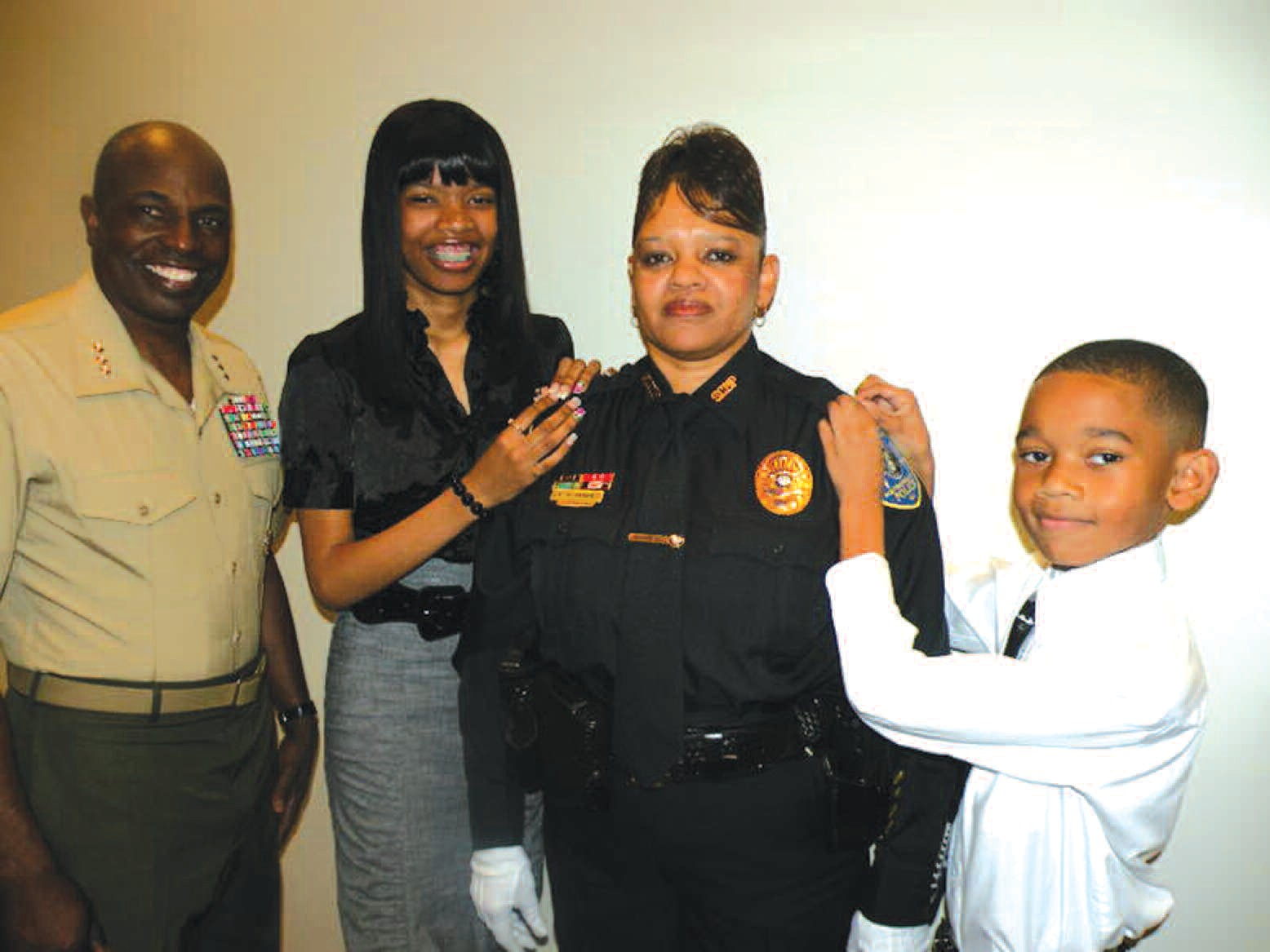 Pictured with Lieutenant Hughes are cousin Lieutenant General Walter Gaskin, daughter Kianni and son Keon.