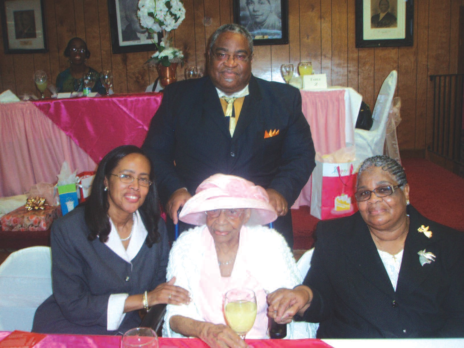 Seated L-R: Mary Ann Foster (First Lady), Alberta B. Stokes (Honoree), Rev. Delores Johnson Standing: Rev. Dr. John Foster