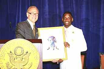 Michael Henderson acccepts the Jefferson Award on behalf of Beach High School