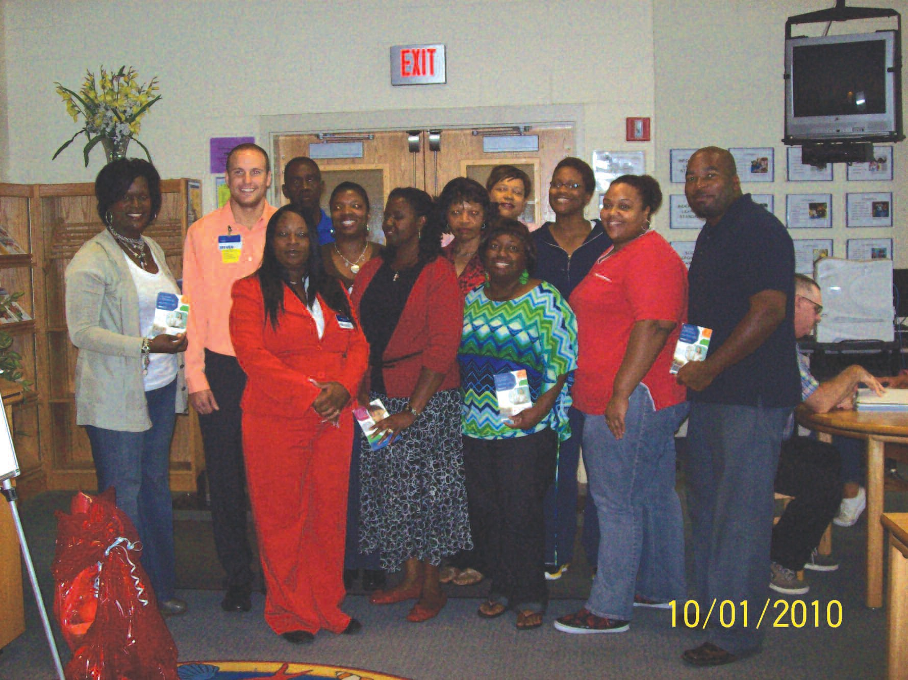 Faculty members of DeRenne Middle School are pictured with representatives from Sam's Club