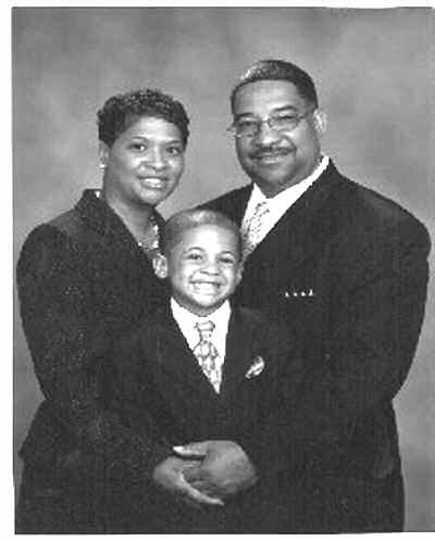The Rev. and Mrs. Paul A. Sheppard and son Justin