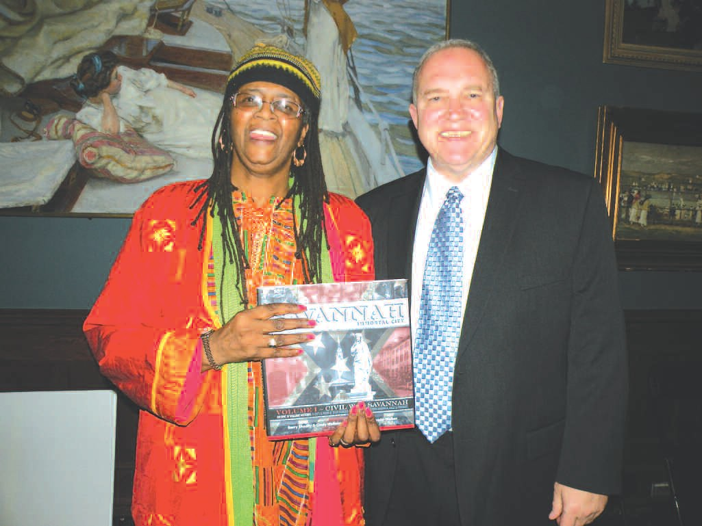Vaughnette Goode-Walker with Barry Sheehy. Walker and Sheehy co-authored Savannah: Immortal City. Photos for the book were taken by Cindy Wallace