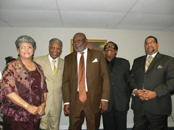 Dr. J. Alphonso Dandy, (center) is pictured with (l-r): wife Evelyn, Rev. Matthew Southall Brown, Sr., Arthur Milton, local artist who painted the photo of Dandy to hang in the Board Room and Rev. Paul Sheppard, Pastor, Thankful Missionary Baptist Church