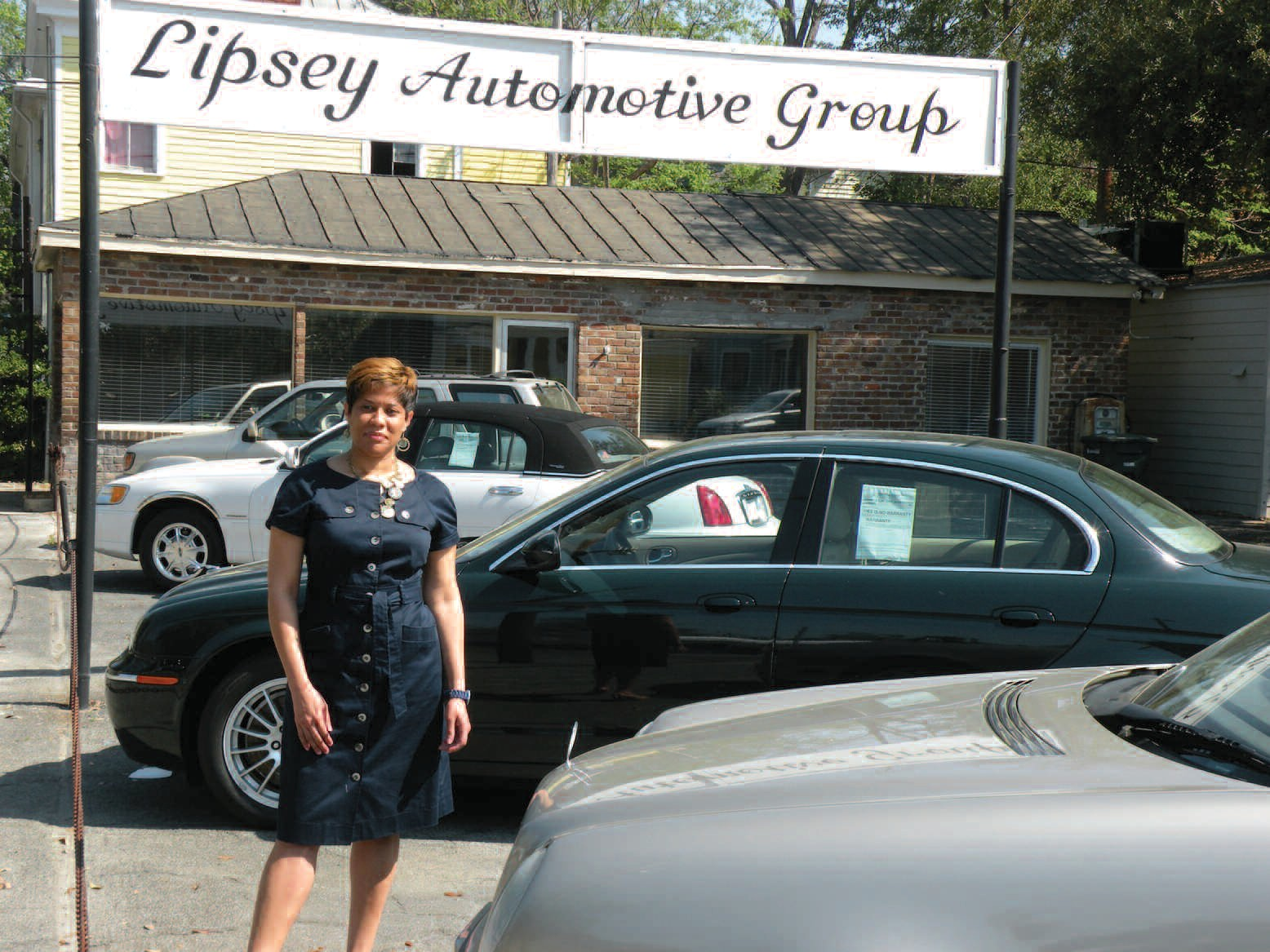 Bernita Lipsey poses on the lot of Lipsey Automotive Group