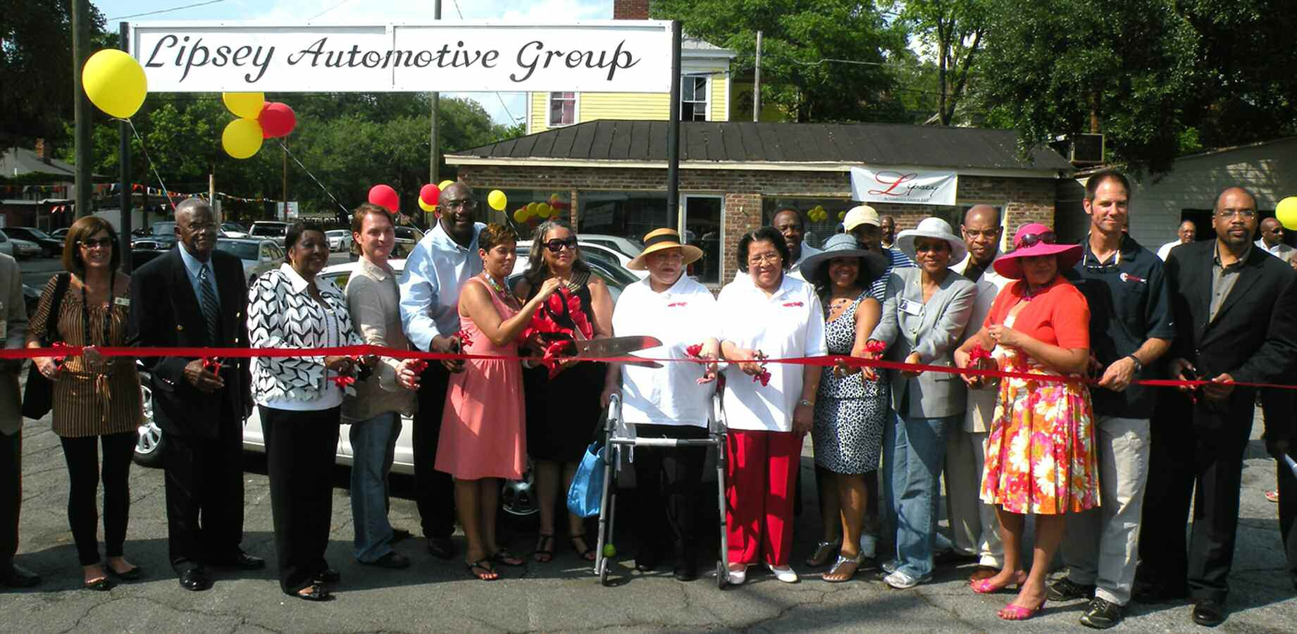 Proprietors of Lipsey Automotive, City officials, and community leaders were on hand for the ribbon cutting on Lipsey Automotive Group