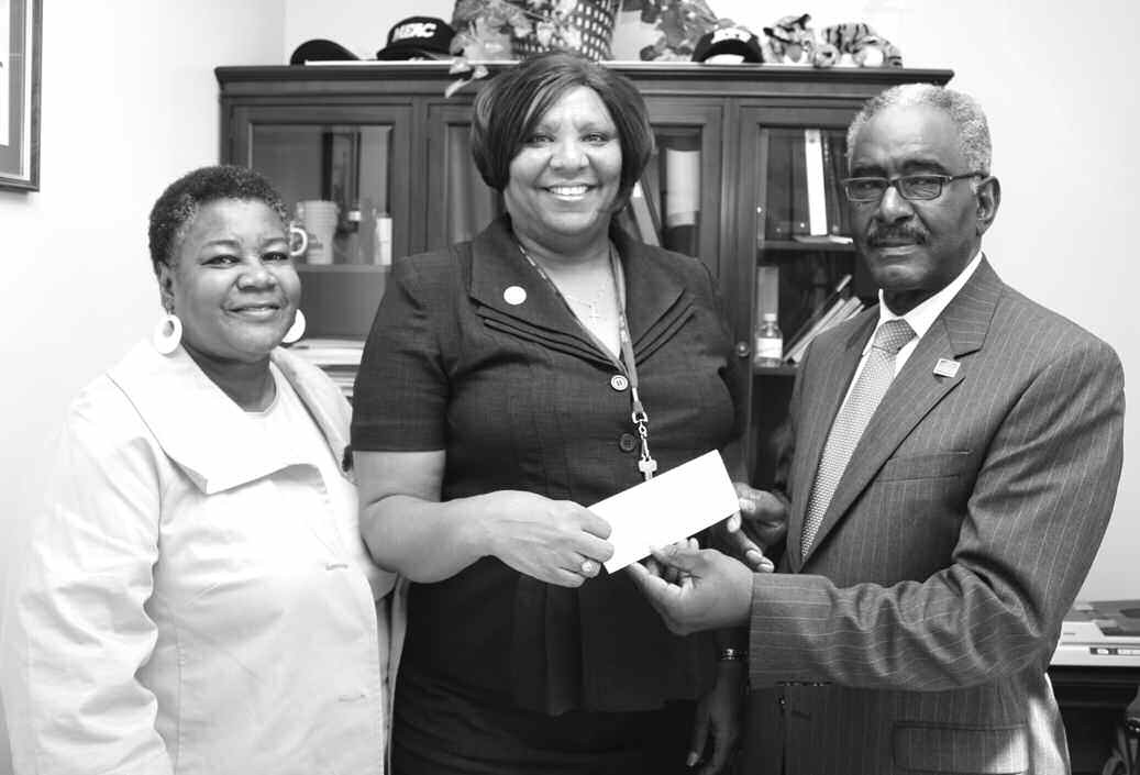 President Roy L. Jackson along with Mrs. Versie DuPont, National Corresponding Secty presenting check to Mrs. Marilyn Suggs, Athletic Director at SSU