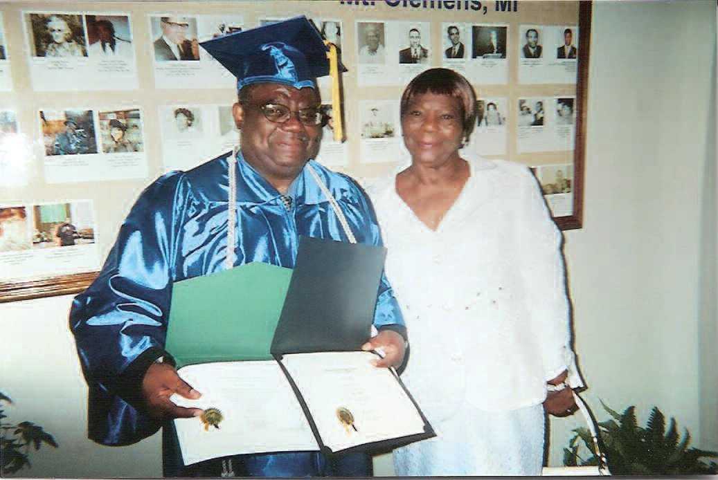 Minister Rufus Bright Jr. and Mrs. Frances Bright Johnson pose following Minister Bright receiving his degree