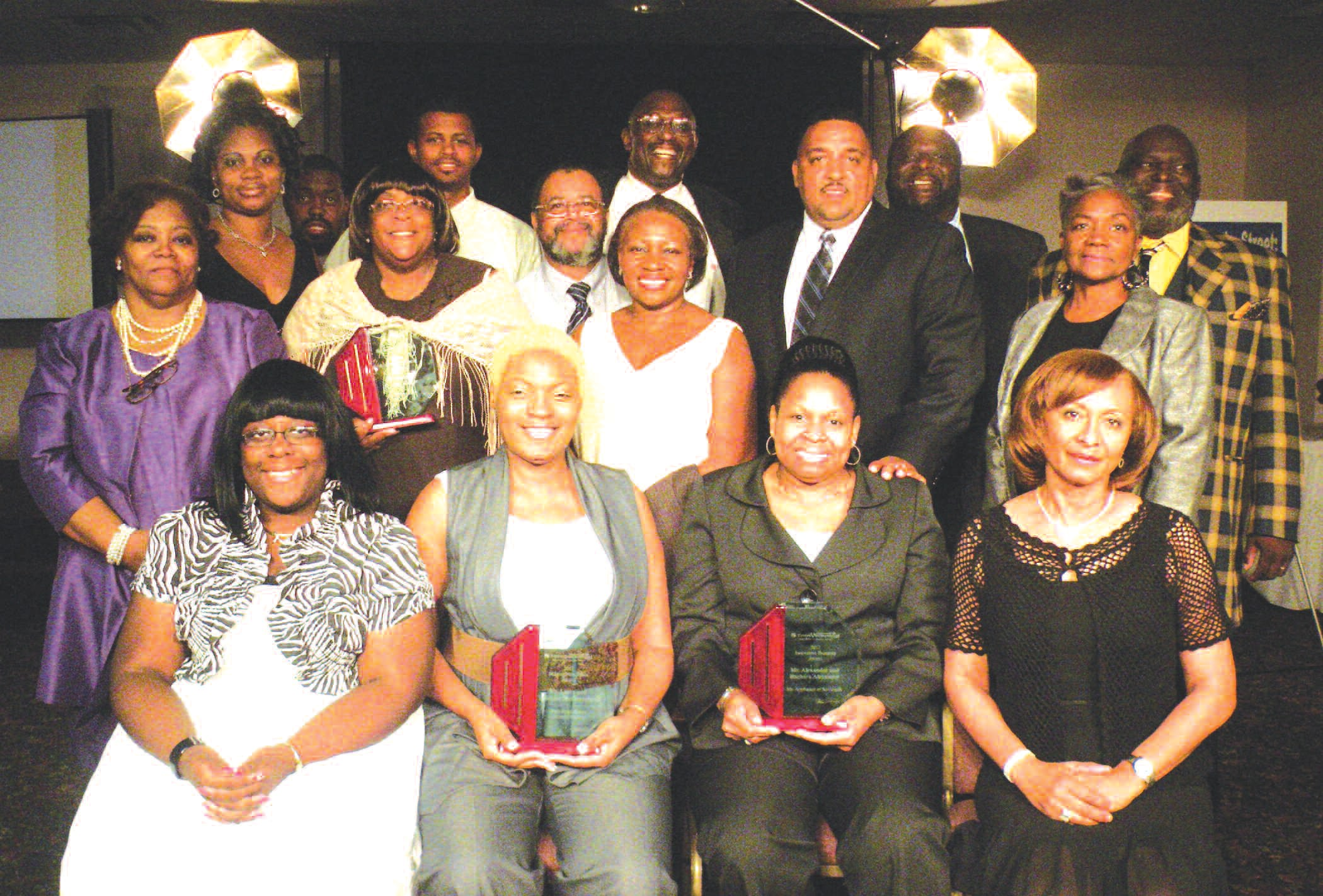 Mrs. Charlena Brown (front, standing) and Mr. Charlie Brown (center, standing) are pictured with Entrepreneurial Center graduates and award recipients