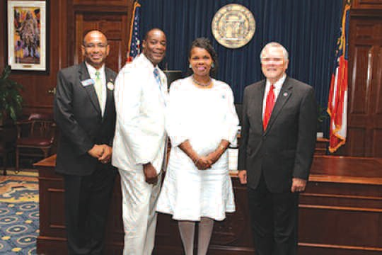 Sheri Saleem Scott (c) poses with Sen. Lester Jackson, husband Gregory and Governor Nathan Deal