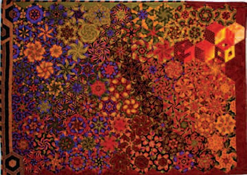 An example of a 'One Block Wonder' quilt by Ellie West, entitled Red and Gold, Bright and Bold.