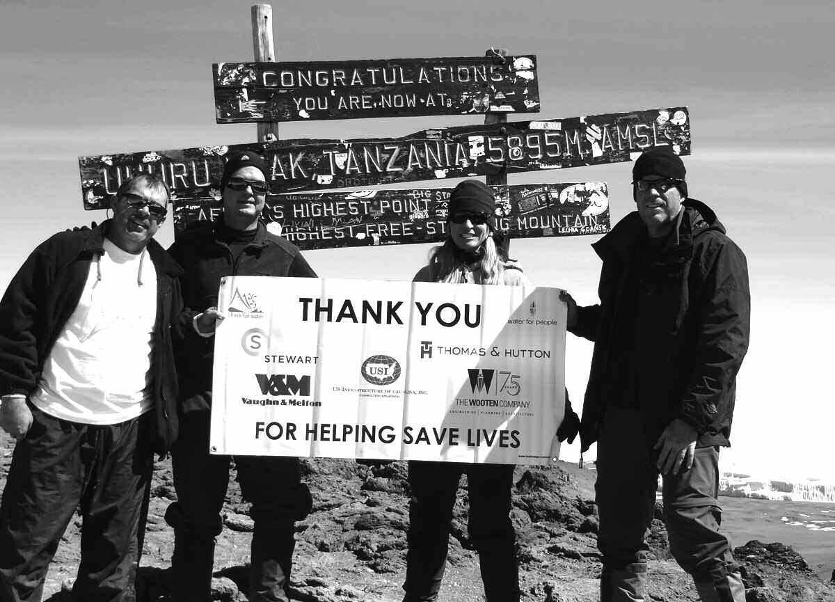 Mt. Kilimanjaro, Africa's Highest Point. Kary Kern, Nuclear Specialist with Duke Energy; Scott Whalen, Water Resource Engineer & Vice President with WK Dickson & Co., Inc.; Tasha Lewis, Hydrologist with CH2M Hill; and Kraig Kern, Director of Marketing with WK Dickson & Co., Inc.