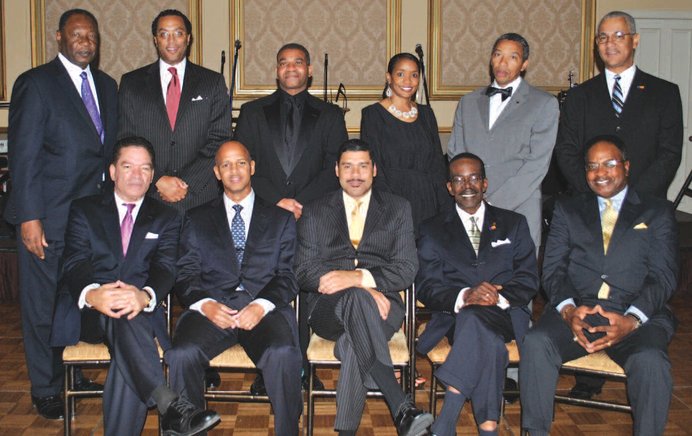 The Directors of the National Bankers Association pose after they were installed by Robert E. James, President, Carver State Bank of Savannah: (Seated L to R) Michael Grant, President of the NBA, Washington, DC; Robert Cooper, Senior Counsel, One United Bank, Boston, MA; D. Doyle Mitchell, Jr., NBA Chairman and President, Industrial Bank. Washington, DC; James E. Young, President, Citizens Trust Bank, Atlanta, GA: and Tony James, Senior Vice President, ICBA Securities, Memphis, TN. (Standing L to R) Robert E. James; Neil Wright, President, First Tuskegee Bank, Montgomery, AL; Erbert Johnson, President, North Milwaukee State Bank, Milwaukee, WI; Cynthia N. Day, Senior Vice President, Citizens Trust Bank, Atlanta, GA; Preston D. Pinkett, III, President, City National Bank of New Jersey and Sidney King, Liberty Bank and Trust, New Orleans, LA.
