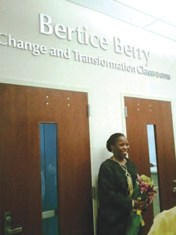 Dr. Bertice Berry stands in front of classrooms named for her